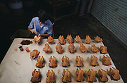 A worker paints plastic chickens at Harry Fujita's plastic food factory in Torrance, California. Iwasaki Images of America.