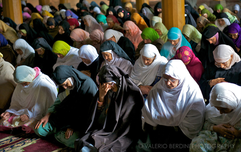 Muslim women pray on the Friday gathering in the appropriate reserved area of Jamia Masjid.