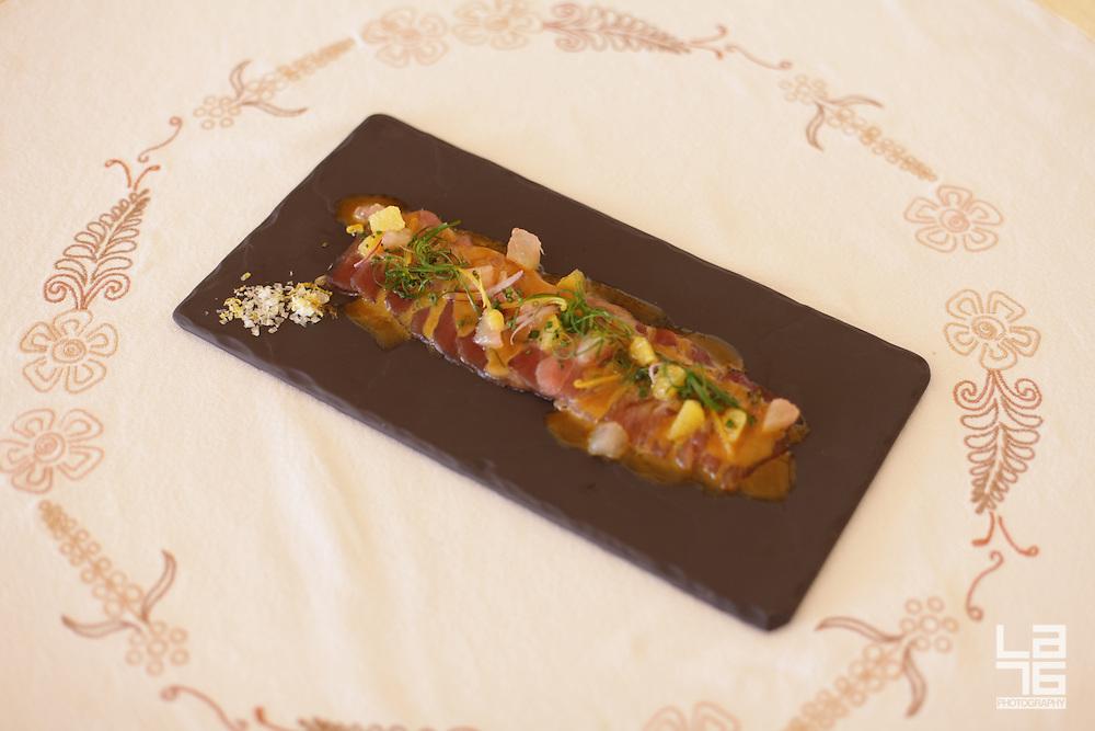 Ensenada Tuna Tiradito, Red Onion, Citrus Segments and Aj&iacute; Amarillo<br /> a Tapas Style Starter (Antojito) at Don Manuel's Restaurant at Capella Pedregal, Cabo San Lucas Hotel and Resort, Mexico