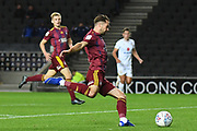 Ipswich Town midfielder Gwion Edwards (7) takes a shot at goal during the EFL Sky Bet League 1 match between Milton Keynes Dons and Ipswich Town at stadium:mk, Milton Keynes, England on 17 September 2019.