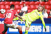 Brighton striker Jiri Skalak & Charlton Athletic defender Jorge Teixeira compete for possession during the Sky Bet Championship match between Charlton Athletic and Brighton and Hove Albion at The Valley, London, England on 23 April 2016. Photo by Bennett Dean.