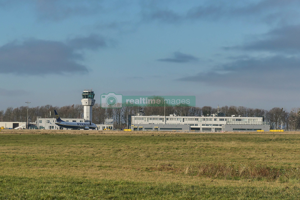 December 16, 2018 - Beek, Netherlands - Ryanair low cost carrier Boeing 737-800 or 737-8AS(WL) with registration EI-EKL seen in Maastricht Aachen Airport MST / EHBK with the terminal building and the Control Tower. (Credit Image: © Nicolas Economou/NurPhoto via ZUMA Press)