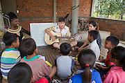 ICS volunteers Luna Boran, Tania Tuzizila, Dan Hensman  & Sokuntheary Nhel run a weekly English class for all children in the village at their host home, in the village of in Banteay Char, near Battambang, Cambodia.