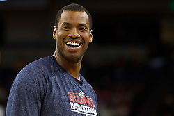 February 25, 2011; Oakland, CA, USA;  Atlanta Hawks center Jason Collins (34) warms up before the game against the Golden State Warriors at Oracle Arena. Atlanta defeated Golden State 95-79.