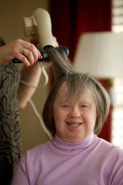 Marybeth Solinski gets her hair styled by her caretaker Celina Zabawa...Aging adults with Down Syndrome. In 1983, people with Down syndrome could expect to live to age 25. Today, their life expectancy is 60 years. We interview a 59-year-old patient who has outlived her parents and is now in AARP. She has trouble walking, but has lots of interests, such as cooking, arts and crafts and reading.