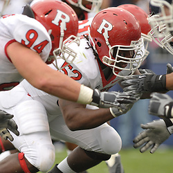 Oct 31, 2009; East Hartford, CT, USA; Rutgers defensive end Eric Legrand (52) breaks off the line during second half Big East NCAA football action in Rutgers' 28-24 victory over Connecticut at Rentschler Field.