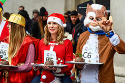 © Licensed to London News Pictures. 07/12/2019. LONDON, UK.  7 December 2019.  Participants line up to take part in The 39th Great Christmas Pudding Race in Covent Garden, raising funds for Cancer Research as well as having lots of festive fun.  Photo credit: Stephen Chung/LNP