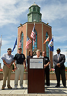 East Meadow, New York, U.S. - September 3, 2014 - Representative CAROLYN MCCARTHY is speaking at podium during press conference when KATHLEEN RICE, (in black jacket dress) Democratic congressional candidate (NY-04), releases a whitepaper on veterans policy and announces formation of her campaign's Veterans Advisory Committee, at Veterans Memorial at Eisenhower Park, after touring Northport VA Medical Center with McCarthy. Congresswoman McCarthy and 4 committee members joined Rice for announcement: PAUL ZYDOR, (in blue shirt) of Merrick, U.S. Navy, Korean War Veteran; PAT YNGSTROM, (in black T-shirt and cap) of Merrick, U.S. Army Paratrooper, Vietnam War Veteran; STEVE BONOM, (in black T-shirt and pants) of Massapequa, U.S. Navy, Vietnam War Veteran; and JEREMIAH E. BRYANT, (wearing American Flag tie and black suit) of Rockville Centre, U.S. Army, Vietnam War Veteran. Rice is in her third term as Nassau County District Attorney, Long Island.