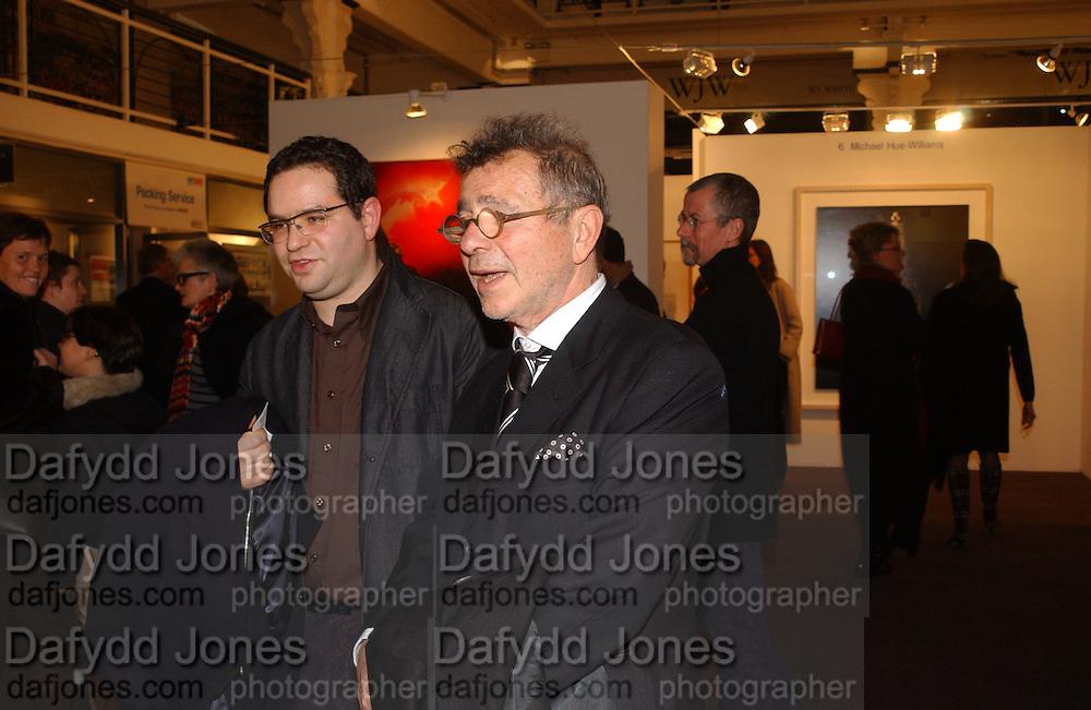 Joseph and Paul Ettendui. Art 2003 London Art Fair opening. Business Design Centre.  14 January 2003. © Copyright Photograph by Dafydd Jones 66 Stockwell Park Rd. London SW9 0DA Tel 020 7733 0108 www.dafjones.com