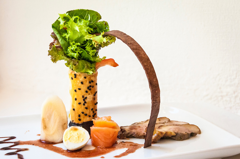 The Royal Resort chef's creation featuring duck, salmon, quail egg and palm heart; Playa del Carmen, Riviera Maya, Mexico.