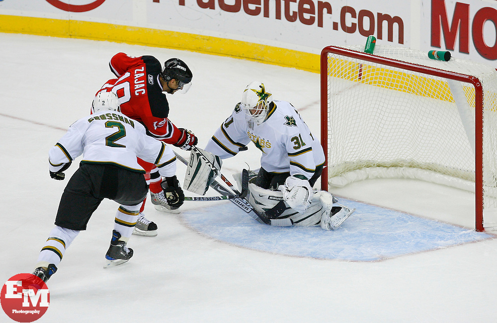 Oct 22, 2008; Newark, NJ, USA; Dallas Stars goalie Tobias Stephan (31) makes a save on a shot by New Jersey Devils center Travis Zajac (19) during the second period at the Prudential Center.