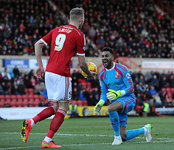 Swindon Town's Michael Smith and Swindon Town's Wes Foderingham - Photo mandatory by-line: Paul Knight/JMP - Mobile: 07966 386802 - 21/02/2015 - SPORT - Football - Swindon - The County Ground - Swindon Town v Crawley Town - Sky Bet League One