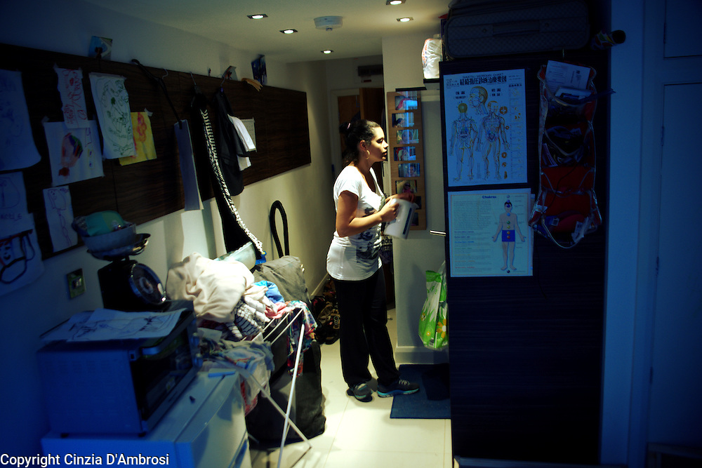 Daniela is a single mum and became  homeless through a series of bad circumstances. The council has offered her a temporary bedsit which she shares with her daughter. Daniela, September 2013.