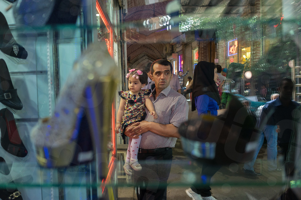 June 08, 2014 - Tabriz, Iran. A father and her daughter shop at the local Grand Bazar, one of the oldest and more important in the country. © Thomas Cristofoletti / Ruom