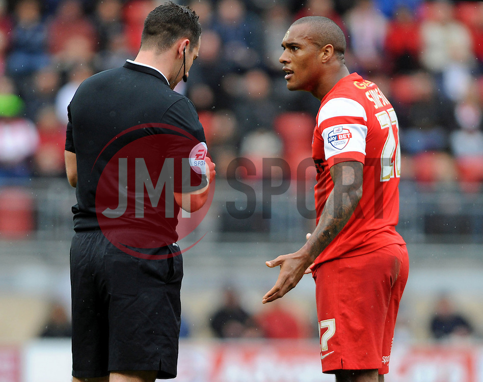 Leyton Orient's Jay Simpson is booked - photo mandatory by-line David Purday JMP- Tel: Mobile 07966 386802 - 04/10/14 - Leyton Orient  v Swindon Town - SPORT - FOOTBALL - Sky Bet Leauge 1  - London -  Matchroom Stadium