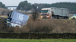 © Licensed to London News Pictures. 03/01/2018. Penrith, UK. A lorry blown off the M6 in Cumbria by heavy winds during storm Eleanor. Gusts of up to 100mph have hit parts of the UK.  Photo credit: John France/LNP