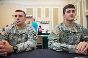 Nick Marquard, left, and Albert Hehr IV, right, of the U.S. Army ROTC attend the 2016 Ohio University Majors Fair held at the Baker Center Ballroom on Wednesday, September 14, 2016.