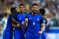 France's Samuel Umtiti celebrates scoring his side's first goal of the game with team mate Olivier Giroud