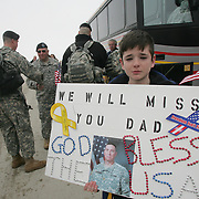 A young boy makes his sentiments known as his father boards a bus on the way to Ft. Riley, Kansas, and then to Iraq for a year of active duty as a National Guardsman.  The send-off ceremony took place in Boone, Iowa, in February, 2007.