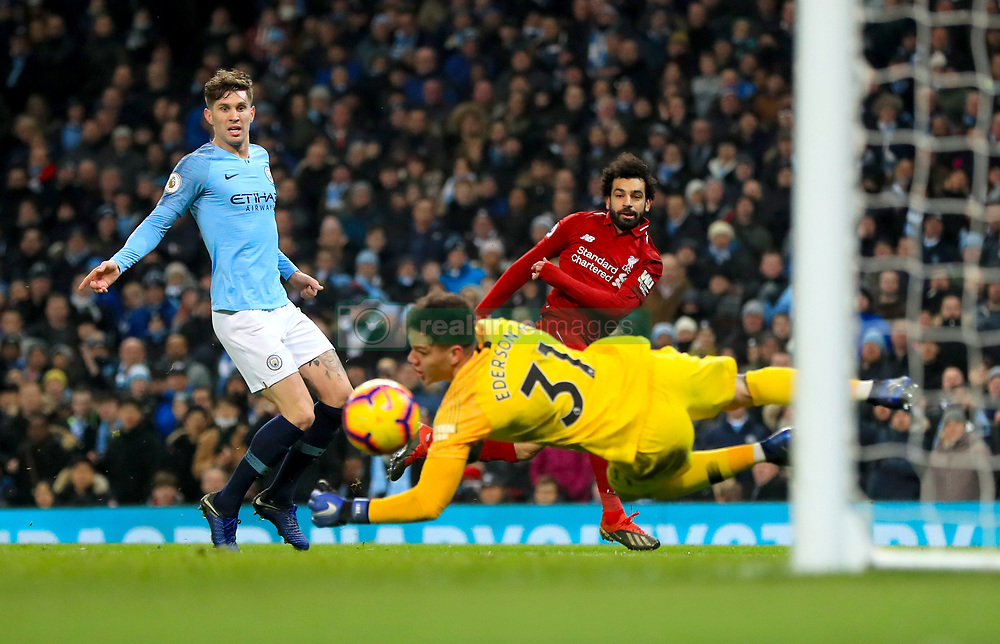 Liverpool's Mohamed Salah has a shot on goal saved by Manchester City goalkeeper Ederson