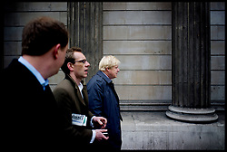 The London Mayor Boris Johnson walking past Bank on his way to Liverpool Street Station to visit Stamford Hill, London, with his Media Director Sam Lyon (middle) Thursday April 5, 2012. Photo By Andrew Parsons/ i-Images...
