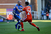 Peterborough Utd forward Marcus Maddison (21) and Shrewsbury Town midfielder Oliver Norburn (29) come together during the EFL Sky Bet League 1 match between Peterborough United and Shrewsbury Town at London Road, Peterborough, England on 23 February 2019.