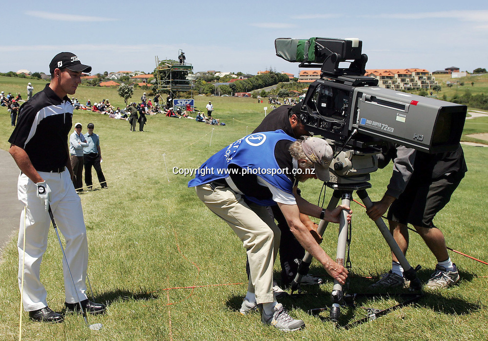 Gareth Paddison (NZL) asks for a tv camera to be moved on the 7th hole on day four of the Blue Chip New Zealand Golf Open at Gulf Harbour, Whangaparoa, New Zealand on Saturday 2 December 2006. Photo: Hannah Johnston/PHOTOSPORT<br /> <br /> <br /> <br /> 031206