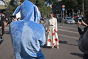 Nina Schwichtemberg, bloggerand founder of Fashiioncarpet.com, poses for photographer outside Ermanno Scervino fashion show during Milan Fashion Week woman collections Spring Summer 2017, Milano September 24, 2016. In the foreground a photographer with a blue dog costume. © Carlo Cerchioli