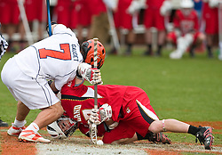 Maryland Terrapins SSM Bryn Holmes (17) wins a faceoff from Virginia Cavaliers D Chad Gaudet (7). The #9 ranked Maryland Terrapins fell to the #1 ranked Virginia Cavaliers 10 in 7 overtimes in Men's NCAA Lacrosse at Klockner Stadium on the Grounds of the University of Virginia in Charlottesville, VA on March 28, 2009.