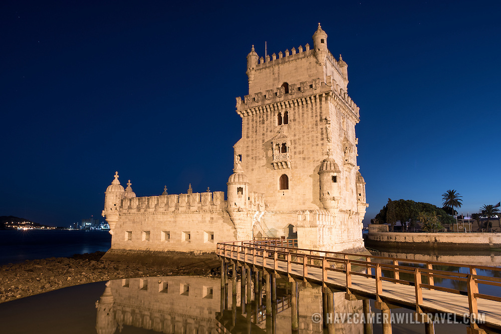 LISBON, Portugal -- Built on a small island near the banks of the Tagus River just to the southwest of downtown Lisbon, the Tower of Belem (or Torre de Belém) dates to 1514-1520. It was part of a defensive network protecting shipping to Lisbon port and beyond during Portugal's Age of Discovery. Paired with the nearby Jerónimos Monastery it is listed as a UNESCO World Heritage Site. The walkway that provides the only access to the tower is in the foreground.