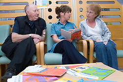 Nurse going through NHS leaflets with patients on the Nottingham City Hospital Renal Unit,