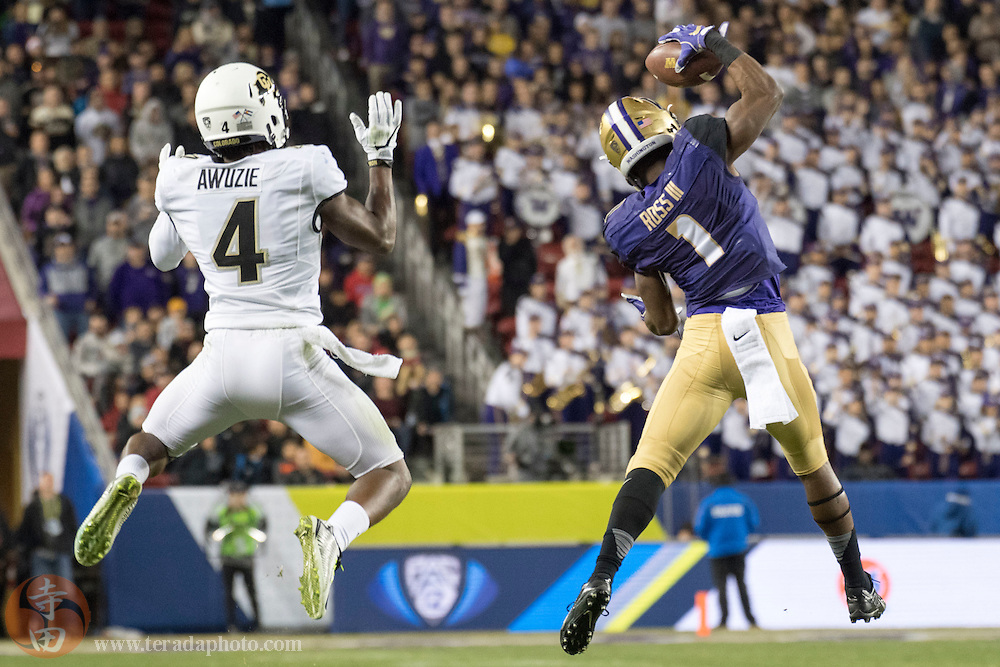 December 2, 2016; Santa Clara, CA, USA; Washington Huskies wide receiver John Ross (1) catches the football against Colorado Buffaloes defensive back Chidobe Awuzie (4) during the third quarter in the Pac-12 championship at Levi's Stadium. The Huskies defeated the Buffaloes 41-10.