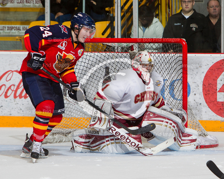 13 October 2012:   Brendan Persley (24) of the Vipers  and goalie Mitch Gillam (1) of the Chiefs during a game between the Chilliwack Chiefs and the Vernon Vipers at  Prospera Centre, Chilliwack, BC.    Final Score: Chilliwack 4  Vernon 1   ****(Photo by Bob Frid - All Rights Reserved 2012): mobile: 778-834-2455 : email: bob.frid@shaw.ca ****