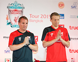 BANGKOK, THAILAND - Monday, July 13, 2015: Liverpool's manager Brendan Rodgersa and Lucas Leiva greet the Thai media during a press conference at the Plaza Athenee team hotel in Bangkok on day one of the club's preseason tour. (Pic by David Rawcliffe/Propaganda)