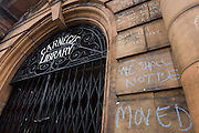 Campaigners locked out of the closed Carnegie Library have written messages in chalk on the front entrance in Herne Hill, south London on 7th May 2016. For ten days, members of the community in the south London borough occupied their important resource for learning and social hub for the weekend. But after a long campaign by locals, Lambeth have gone ahead and closed the library's doors because they say, cuts to their budget mean millions must be saved. A gym is planned to replace the working library and while some of the 20,000 books on shelves will remain, no librarians will be present to administer it. London borough's budget cuts mean four of its 10 libraries will either close, move or be run by volunteers.