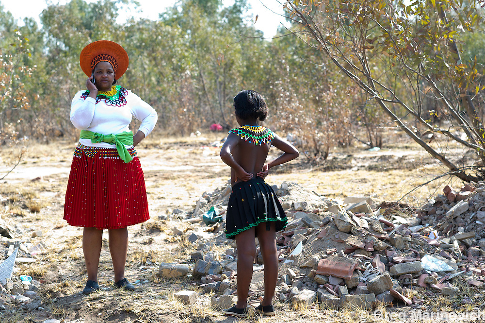 Riverlea, Johannesburg, South Africa, August 20, 2011. Virginity testing is an ancient Zulu and Southern African Nguni custom that was revived in the time of Aids to try and find a way protect young girls from the disease, as many fall victim to rape and abuse. It is also a way to celebrate celibacy in a nation with massive HIV rates. Despiote this, there are many critics who say that it either humiliates the girls or marks them as targets for rape as there is a persistant belief that sleeping with a virgin cleanses one of Aids. This ceremony in dumpland near Soweto was named as Umhlonyana or Sweet 16 ceremony to acknowledge Lerata Ndlela's adolescence (she turned 15). Two of the girls were found not to be virgins, and Gogo Thembi Sibisi, a scion of Zulu culture, counselled them and sent other group adults to meet with their parents. This girls had been raped by an adult neighbour and the group helped lay charges, but to no avail a year later. Photo Greg Marinovich / Storytaxi.