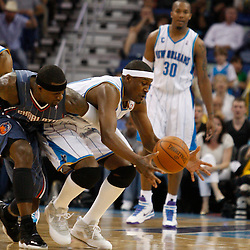 Apr 07, 2010; New Orleans, LA, USA; New Orleans Hornets forward James Posey (41) and Charlotte Bobcats guard Stephen Jackson (1) scramble for a loose ball during the second half at the New Orleans Arena. The Bobcats defeated the Hornets 104-103. Mandatory Credit: Derick E. Hingle-US PRESSWIRE