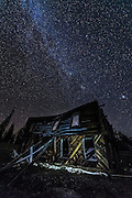 Nighttime at an abandoned cabin near Telluride, Colorado. Clear skies and bright stars.