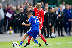 WREXHAM, WALES - Tuesday, August 13, 2019: Wales' Gwiob Edwards and Cyprus' Andreas Christou during the UEFA Under-15's Development Tournament match between Wales and Cyprus at Colliers Park. (Pic by Paul Greenwood/Propaganda)