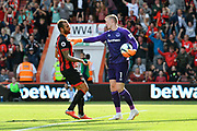 Steve Cook (3) of AFC Bournemouth trys to retrieve the ball but is pushed away by Jordan Pickford (1) of Everton after Nathan Ake (5) of AFC Bournemouth scored the equalising goal to make the score 2-2 during the Premier League match between Bournemouth and Everton at the Vitality Stadium, Bournemouth, England on 25 August 2018.