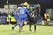 AFC Wimbledon striker Lyle Taylor (33) attacking the ball in the box during the EFL Sky Bet League 1 match between AFC Wimbledon and Wigan Athletic at the Cherry Red Records Stadium, Kingston, England on 16 December 2017. Photo by Matthew Redman.
