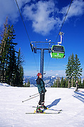Woman skier and gondola at Silver Mountain Ski Resort. Near Kellog, north Idaho.