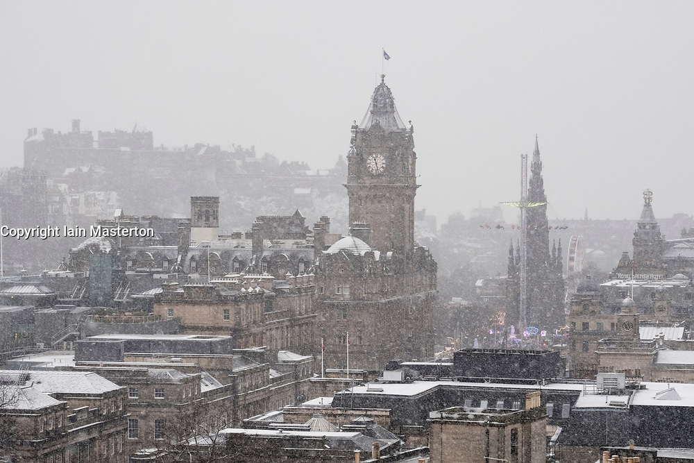 Edinburgh, Scotland, United Kingdom. 29 December, 2017; Snow falls on Edinburgh enhancing views of the city. View from Calton Hill of the city.