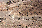 Horse-riding between the ridges seen from above in Valle de la Luna, in Chile's Atacama desert, near San Pedro de Atacama