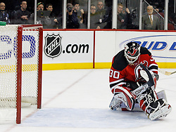 February 13, 2008; Newark, NJ, USA;  New Jersey Devils goalie Martin Brodeur (30) holds on to the puck after a shot by the Ottawa Senators during the third period at the Prudential Center in Newark, NJ. The New Jersey Devils beat the Ottawa Senators 3-2 on an overtime goal by New Jersey Devils right wing Brian Gionta (14).