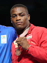 England's Cheavon Clarke takes bronze in the Men's heavyweight final at Oxenford Studios during day ten of the 2018 Commonwealth Games in the Gold Coast, Australia.