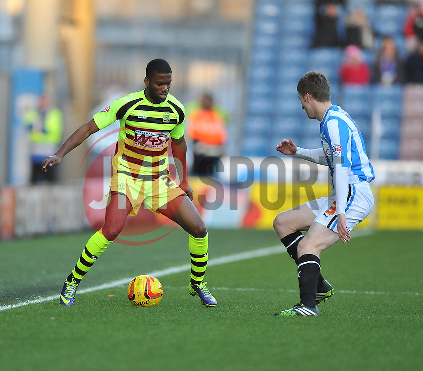 Yeovil Town's Joel Grant looks to attack down the wing under pressure from Huddersfield Town's Paul Dixon - Photo mandatory by-line: Alex James/JMP - Tel: Mobile: 07966 386802 29/12/2013 - SPORT - FOOTBALL - John Smith's Stadium - Huddersfield - Huddersfield Town v Yeovil Town - Sky Bet Championship
