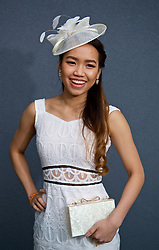 LIVERPOOL, ENGLAND - Thursday, April 6, 2017: Yaya Srising, 20 from Thailand wearing a dress from Misguided, during The Opening Day on Day One of the Aintree Grand National Festival 2017 at Aintree Racecourse. (Pic by David Rawcliffe/Propaganda)