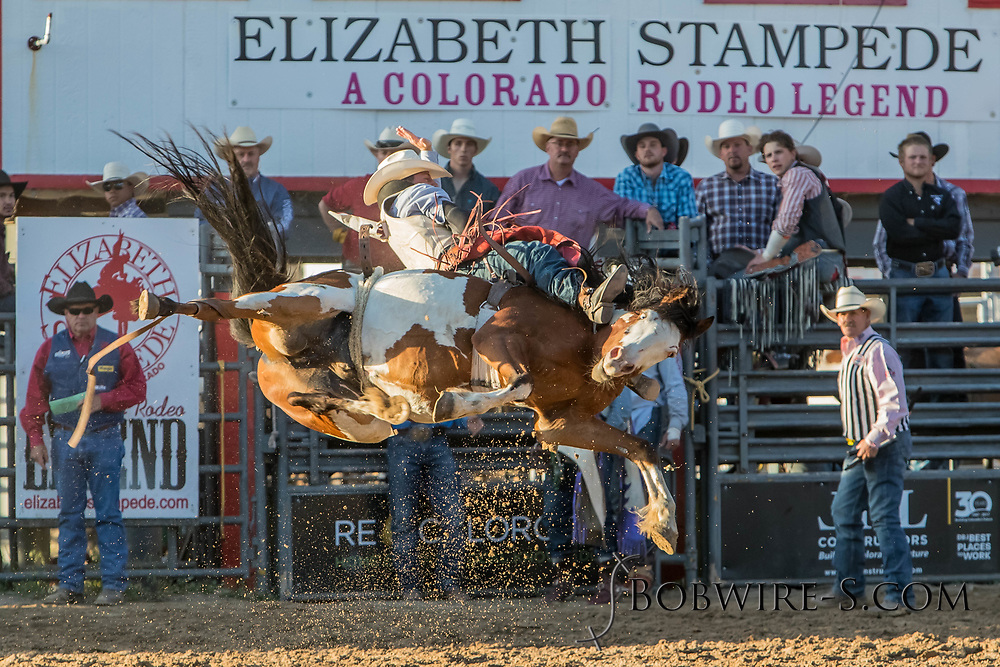 Bareback bronc rider Bull Tutor rides Summit Pro Rodeo's 209 in the second performance of the Elizabeth Stampede on Saturday, June 2, 2018.