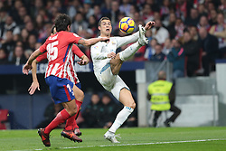 Cristian Ronaldo (C) jugador del Real Madrid pelea un balón ante Savc Jugador del Atlético de Madrid.en el Atlético de Madrid vs Real Madrid jornada 12 del futbol español realizado en el estadio SWanda metropolitano. Madrid, Spain 18/11/2017. Partido finaliza 0-0.Foto: Juan Carlos Rojas..Cristiano Ronaldo (R) players of Real Madrid fight  againt Savic player Atlético de Madrid during the Spanish league football match  12 between Atlético de Madrid vs Real Madrid at Wanda Metropolitano  stadium in Madrid, Spain, November 18 2017. (Credit Image: © Juan Carlos Rojas/Xinhua via ZUMA Wire)